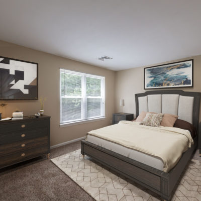 A well-decorated bedroom with a brown and white color scheme at the Northwood Apartments
